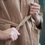 man tying his bathrobe | Things To Consider When Purchasing A Men's Robe | men's robe | waffle men's robe | Featured