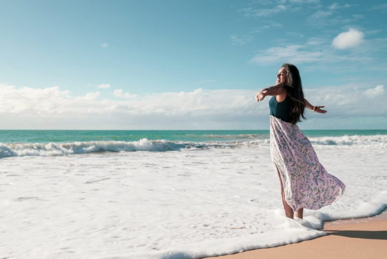 Featured | happy girl on the beach | Stylish Beach Cover Ups For Every Body Type | beach cover ups | swimsuit cover up
