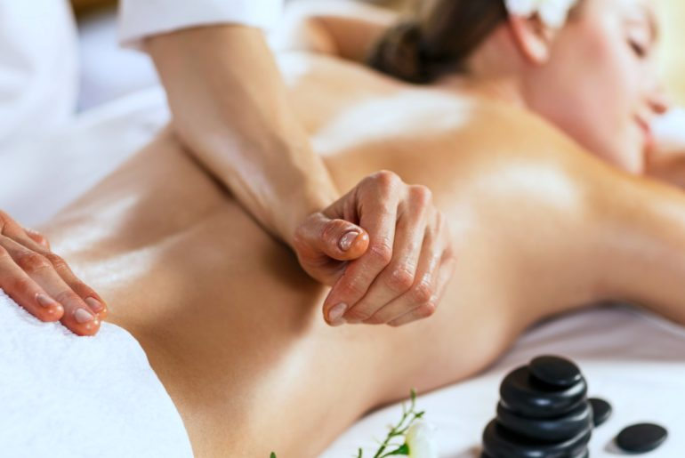 woman enjoying her back massage | Reasons Why You Deserve A Relaxing Massage | relaxing massage | relaxing back massage | Featured