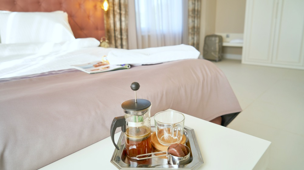 hotel bed and coffee | Ways To Improve Hotel Guest Experience | hotel guest | guest experience