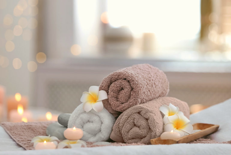 Beautiful spa composition on massage table in wellness center | Simple Tips For Buying Wholesale Salon Towels | microfiber salon towels wholesale | Featured