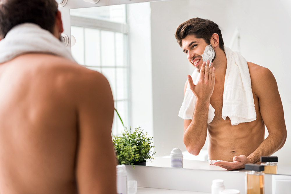 Happy guy is ready to shave | Airbnb Bathroom Essentials To Stock For Your Guests | airbnb essentials
